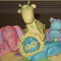 Animal Friends Baby Shower (Close-Up Animal View) This is a close-up of the animals on my Animal Friends Baby Shower cake. Animals are MMF mixed with gum tex powder and painted in luster...