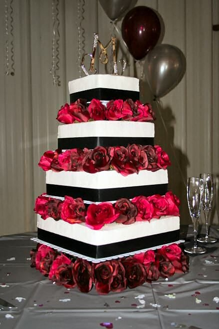 Cassandra's Elegance 4-tier square wedding cake adorned with black ribbons and silk maroon roses. Flavors: wedding white, chocolate and strawberry with white...