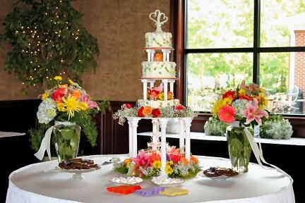 Heather's Garden Basket weave fountian garden wedding cake surrounded by fresh flowers of summer