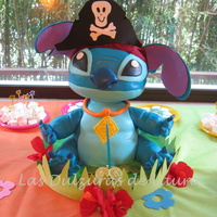 Stitch  Carved chocolate cake, filled with dulce de leche and chocolate cream, covered in fondant. Head and arms are made of styrofoam, carved. TFL...