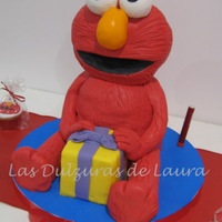Elmo   Vanilla carved cake, with chocolate cream and dulce de leche filling, covered in fondant. TFL!