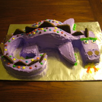 Purple Dinosaur Not Barney This is a cake of a purple dinosaur done for a birthday party.
