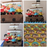 "Baby Pirate Bounty Pirates for a boy, turning two ... Idea from the cover of the 2010 Wilton Yearbook. What FUN!! Pirates are ""dressed"" cupcakes..."