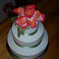 Gumpaste Flower Wedding Cake This was my first wedding cake, done for a wedding last Sunday. The gumpaste flower was inspired from a piece of fabric provided by the...