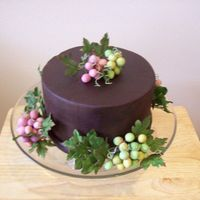 Gumpaste Grapes  I made this cake for the county fair. It is covered in chocolate fondant and I hand made and dusted each and every grape. It is a copy of a...