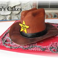 Cowboy Hat Cowboy hat made with the wonderful directions on this site! Barbed wire was my own little twist! just twisted some black and brown fondant/...