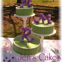 Green And Purple Made for a friend who got the idea from a magazine. Very beautiful outdoor wedding! Initials were made from floral wire, and silk flowers...