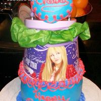 "Chelsea Birthday Small 6"" cake with a metal Hanna Montana purse like thing on top of cake, filled with tissue paper and her gift, a watch. Top of cake..."