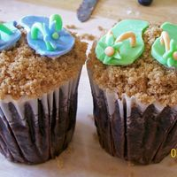 Flip Flops In The Sand Cupcakes   these are cupcakes with buttercream icing, dipped in brown sugar. the flip flops are fondant