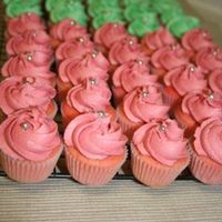 Mini Cupcakes These were made for a graduation luncheon. They were colored to match the invitations, pink and green. Strawberry with vanilla bc.