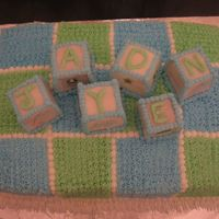 Baby Shower Block/quilt Cake This cake was made for a baby shower -devil's food with vanilla bc. The blocks were cut from a square cake and covered with rolled...