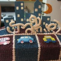 Completed City Cake This is the city cake completed. The name was made out of mmf. The cake is red velvet with vanilla bc. I had some trouble with the name - a...