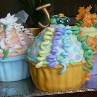 Giant Birthday Cupcakes Inside is yellow cake.. outside all fondant