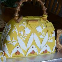 Italian Purse Cake I made this for a church auction... I solf for $600.00 Mona Lisa is also edible...100% edible, cake and mona lisa