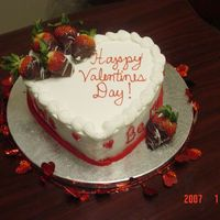 Heart Shaped Cake Chocolate Cake with BC filling. Strawberries dipped in chocolate and white chocolate stripes.