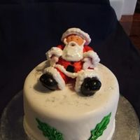 Santa this is the fourth of the mini christmas cakes i made for my mum, its fruit cake with fondant, santa is gumpaste with royal beard etc,...