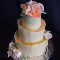 Mini Wedding Cake this is a chokolate fudge cake with strawberry bc filling , covered with butter cream and white chockolate collars, gumpaste roses.. this...