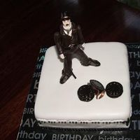 Charlie Chaplin this was a cake a lady ordered from me for her son who is a huge fan of charlie chaplin... the end result had more movie film than what is...