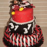 Micky And Minnie Cake this is a 31st birthday cake i made for my friend in november, it is caramel mud cake ( bottom) with rolled buttercream, chock hazelnut...