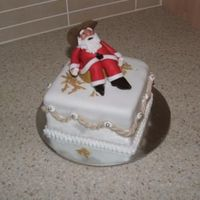 "Cowboy Santa this is 3 of 4 christmas cakes i made for my mum, its 4"" fruit cake with fondant, santa is gumpaste and he is sitting on a gumpaste..."