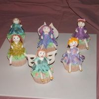 Fairy Cupcakes these are gumpaste fairys sitting on vanilla cupcakes... just made them for something to do...you cant see to well but they are all dusted...