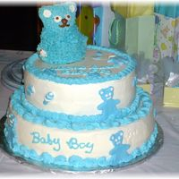 Baby Boy Shower Cake Almond cake with almond icing. Figures around cake are fondant.
