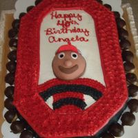 Brutus Buckeye Cake   For my Ohio State loving sister's 40th birthday. Cake surrounded by peanut butter buckeyes, Brutus head is fondant.