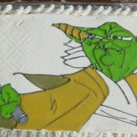 Yoda Buttercream with royal icing. This is my first cake ever and its for my son's 5th birthday.