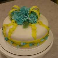 My Final Class Cake   This cake was for my last Wilton cake decorating class. It is a yellow cake covered with fondant and has gum paste flowers.