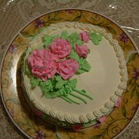 Pink Flowers   wasc cake with pineapple delight filling. Iced in non dairy whipped cream , wanted to see if i could make flowers with it .