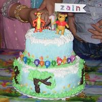 My Babys First Birthday my first tiered cake. bottom was wasc with pineapple and top was chocolate version of wasc with cherry filling. with whipped creme.design...