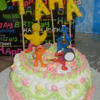 Elmo N Cookie Monster this was my third cake ever about 2 years ago . after this i decided never to decorate a cake again. Then i took wilton course 1 and...