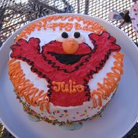 "Elmo-Tastic I made this cake for my daughter's second b day. It is a 10"" vanilla buttermilk cake with cotton candy icecream filling and..."