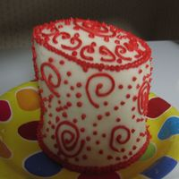 Amy's Mini Red And White Cake This was made for a tea party for two. It is frosted and decorated with buttercream.
