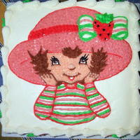 "Strawberry Shortcake This is a 10"" marble strawberry and chocolate cake with vanilla filling, covered in BC. The caracter is piped BC. Very simple, but..."