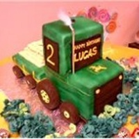 John Deere Tractor Cake This tractor was made with chocolate cake filled with bavarian cream on the bottom, and pound cake filled with mixed berries cream for the...