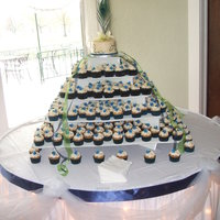 Wedding Cupcake Tree This was my niece's choice for her wedding. I made over 300 cupcakes in vanilla, chocolate and maple flavors, covered in ivory BC. The...