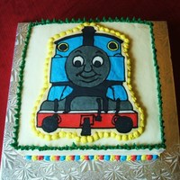 "Thomas Train Engine This is a 10"" square marble chocolate and vanilla cake with mixed berries filling. I made Thomas the Train Engine using the frozen..."