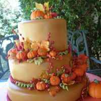 Fall Wedding Cake this one is one of my favorites! i made this for my cousins wedding :) the pumpkins and leaves are make of gum paste and the cake it self...