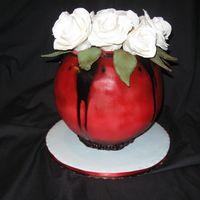 Red Vase With Cake Bite Roses   I made this cake after a design I LOVE but could never find. All the roses are cake bites. The petals are modeling chocolate.