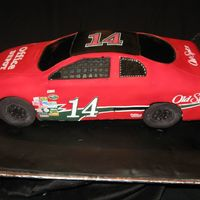Tony Stewart Nascar The cake was placed on a styrofoam wedge so that it would look like it is going around a track. The angle was a bit precarious but the...