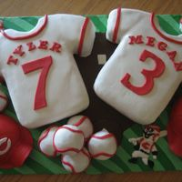 Cincinnati Reds  Wedding shower cake for a couples shower that had a Cincinnati Reds theme. The couple is getting married July 3, hence the 7 and 3 on the...