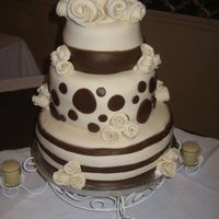 Wedding Cake  A three tiered cream and brown round wedding cake I made for my friends wedding. Cakes covered in marshmallow fondant and all are fondant...