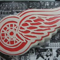 Red Wings  11x15 half vanilla, half chocolate cake with buttercream. Sculpted and covered in fondant. Three layers of fondant to get full effect for...