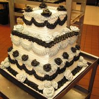 My First Wedding Cake! This is my first Wedding cake! Although to me it looks more like a funeral cake their colors were black & silver so this is what they...