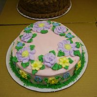 Pink Easter Egg Roses & Daisies are piped from buttercream, Daffodills & Forget-Me-Nots are sugar flowers.