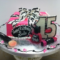 Sweet 15 all buttercream iced with fondant bow and accents