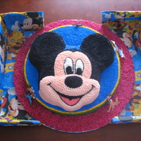 Mickey And Friends sponge cake covered with buttercream icing, the figures are sugarpaste, which I hand made as I could not find any figurines