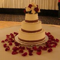 First Wedding Cake My first wedding cake! It took forever, but I feel so good that it turned out alright. Very simple, 14/10/6 in buttercream with burgundy...