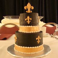 Saints Groom's Cake This was my first wedding and I had the grooms cake and the wedding cake! It's a 6in and 4in cake (very hard to work with!! Covered in...